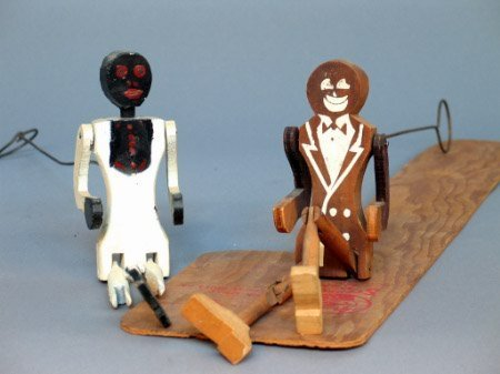 2224: TWO STEPPIN SAM FIGURES. The lot includes two woo
