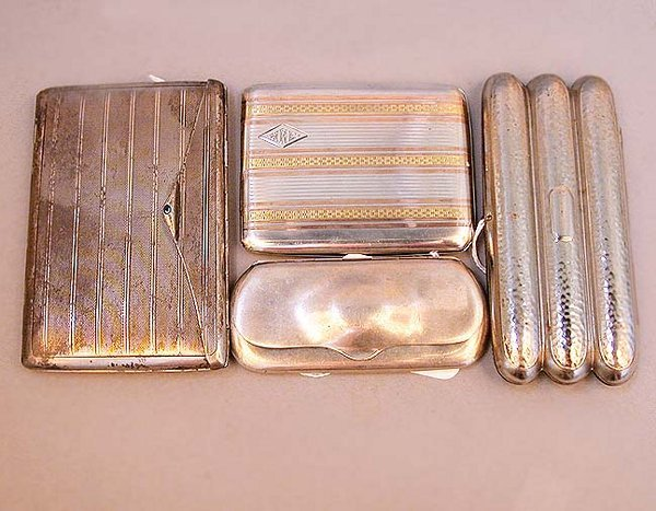 2024: 2024 FOUR STERLING CIGARETTE CASES. One