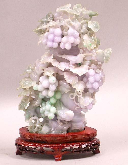 2081: 2081 JADEITE SMALL VASE. Carved jadeite