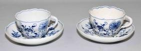 (2) MEISSEN BLUE ONION CUP & SAUCER SETS - Condition: