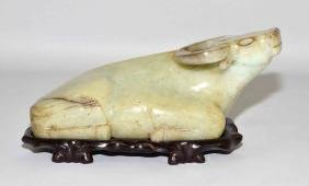 SPINACH JADE BULL - Bull resting on stomach, looking up;