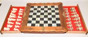 HAND CARVED BONE CHESS SET IN CARVED WOOD BOARD -