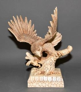 CARVED BONE EAGLE SCULPTURE - Eagle perched on tree