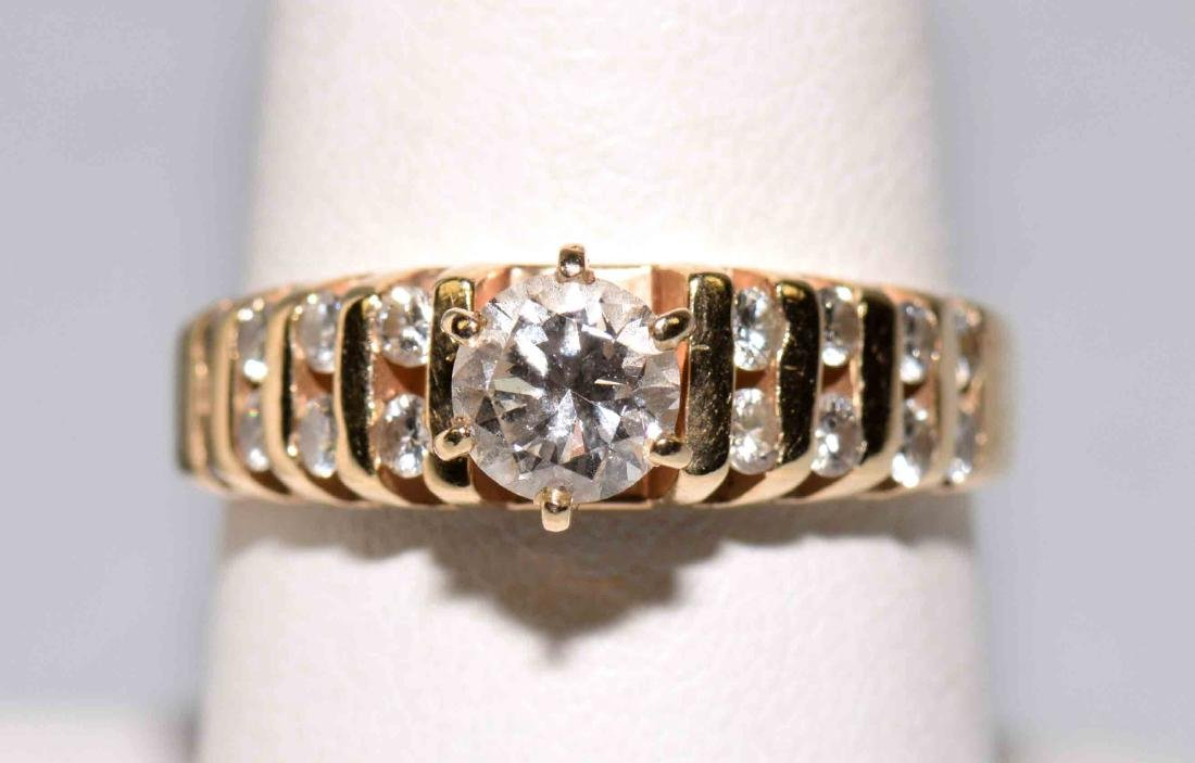 14k YELLOW GOLD CHANNEL ENGAGEMENT RING - Round