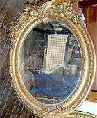 2620: Empire Oval mirror carved wood gilt