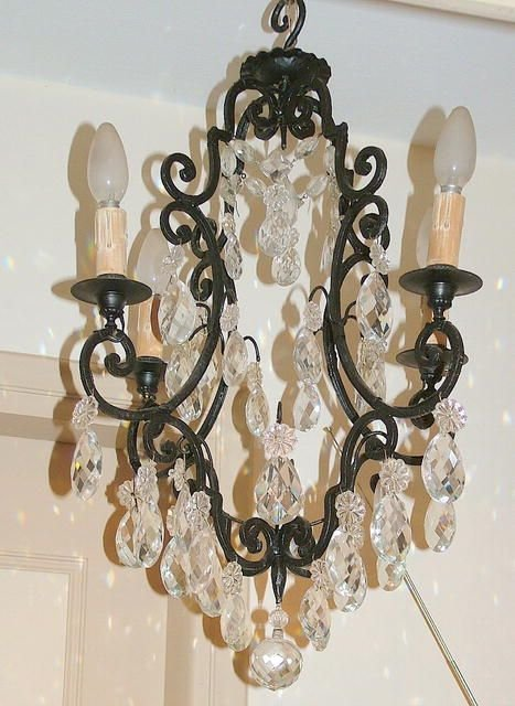 1232: Antique Wrought iron 4 lights chandelier