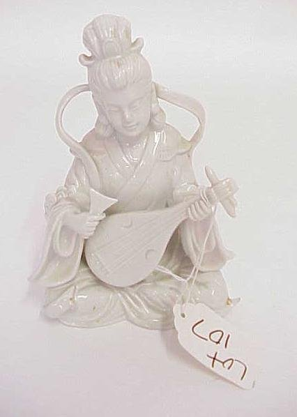 107: ASIAN WHITE POTTERY FIGURINE WOMAN WITH INSTRUMENT