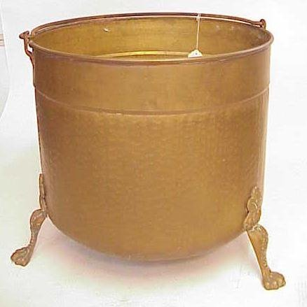 2022: TALL FOOTED BRASS PLANTER W LION FEET NR