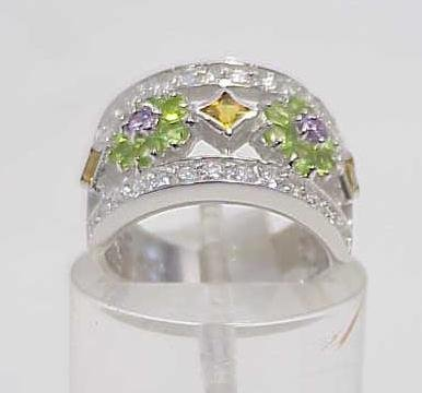 3017: STERLING SILVER MULTI COLORED STONE RING SIZE 7