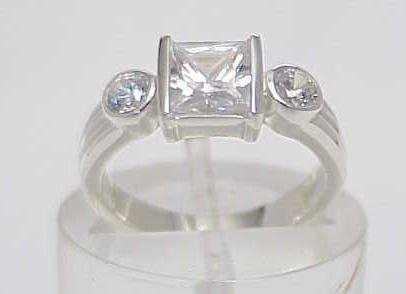 3009A: STERLING SILVER SIM DIAMOND CZ 3 STONE RING 7