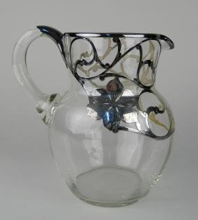 Glass pitcher with sterling silver overlay