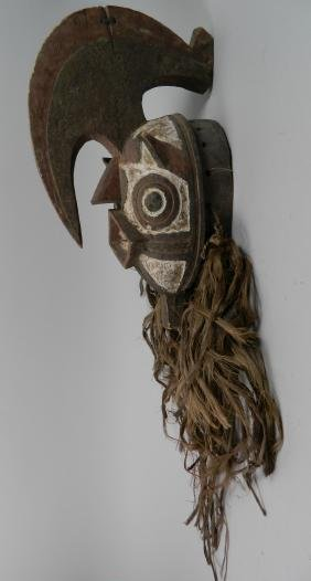 African carved and painted wood mask