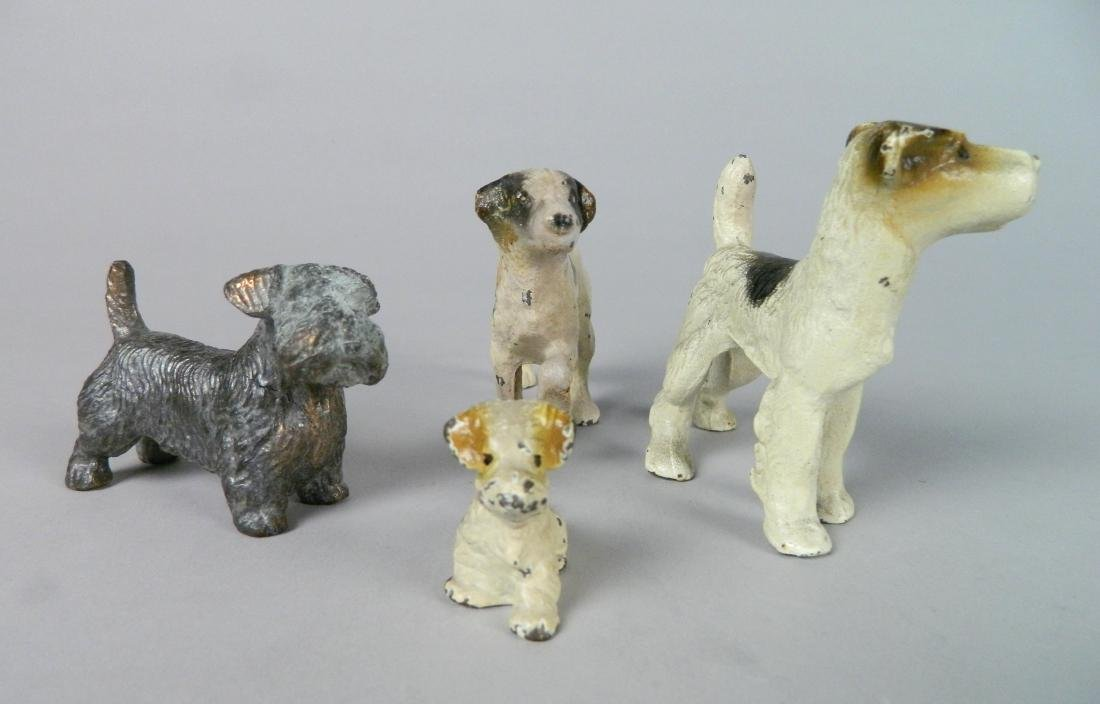 4 Bronze dog sculptures