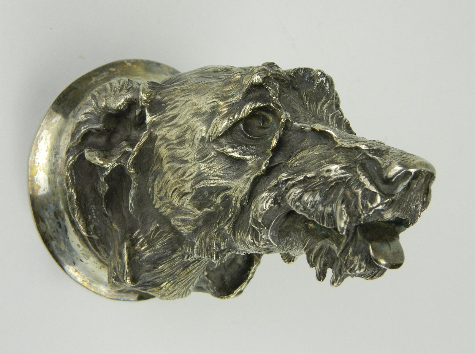 Silver over bronze sculpture of a dog's head