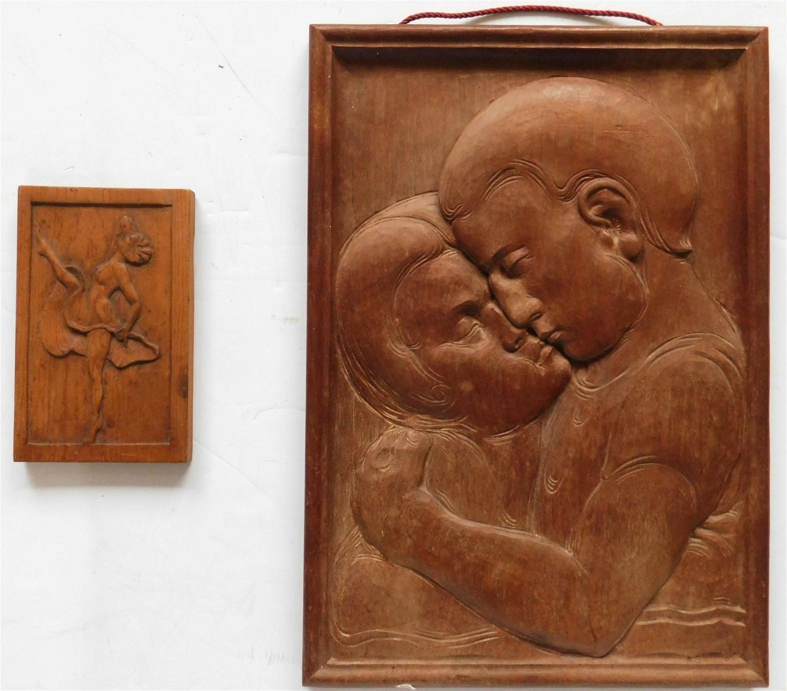 2 American carved wood plaques