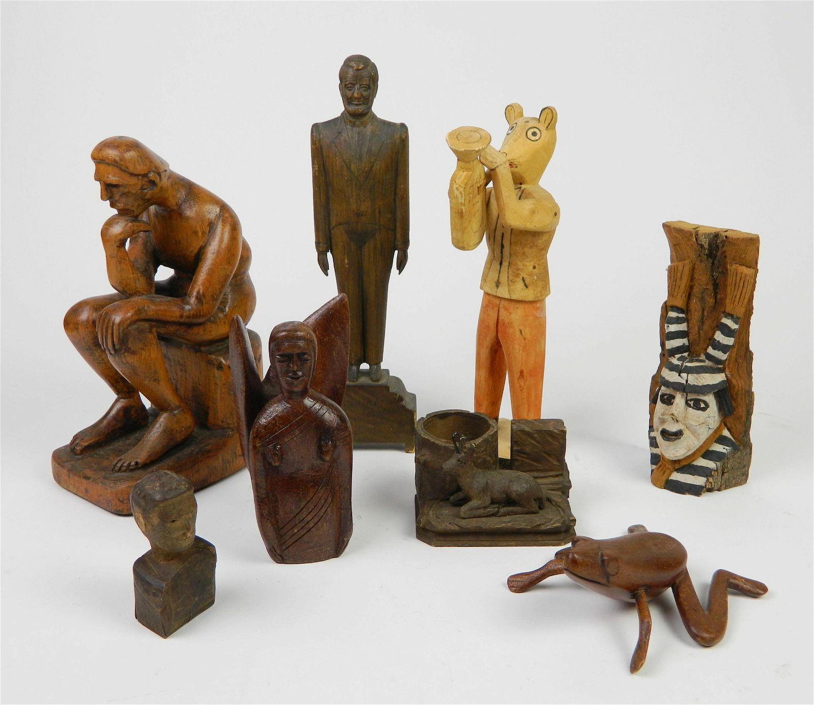 8 American folk art carved wood figures