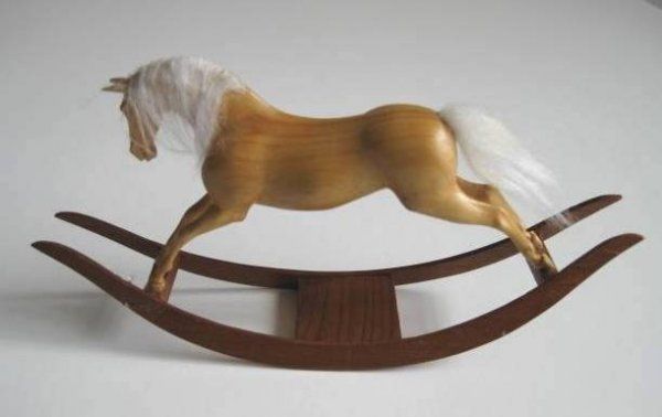 713: Miniature wooden rocking horse