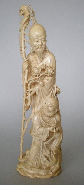 796: A Chinese ivory figure of two immortals