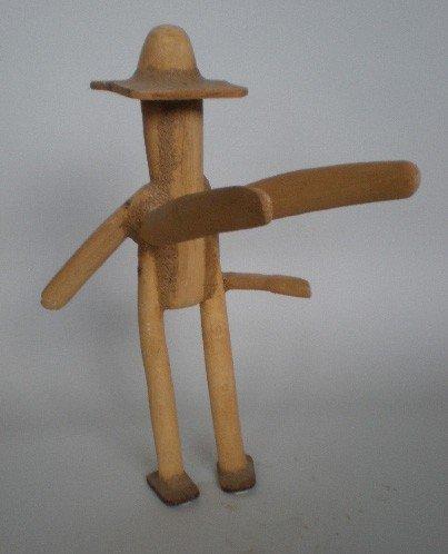 22: Eduardo Lozano wood sculpture