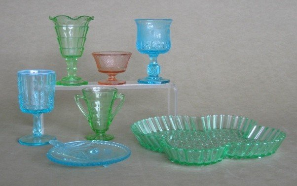 25: 7 Carnival glass and 4 pressed glass items