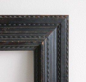 704: Black frame with running dash motif
