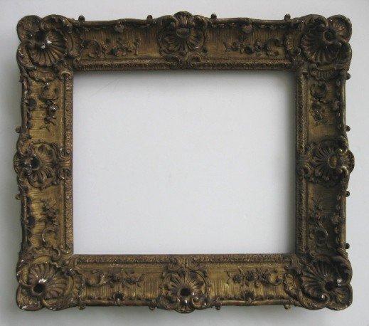 759: Ornate hand carved gilded frame