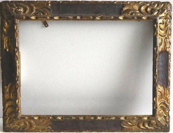 857: Hand carved dark wood frame