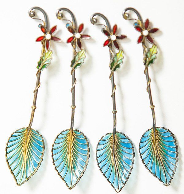 Four Plique a Jour spoons, leaf forms in blue and green