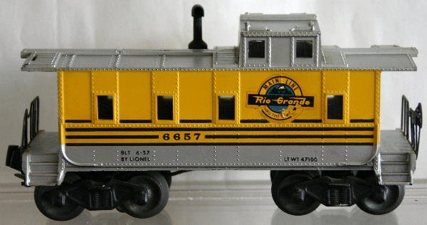 742: POSTWAR RIO GRANDE CABOOSE. DECAL BAD ON ONE SIDE