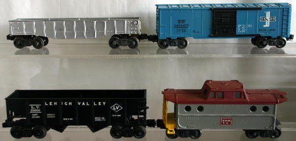 744: POSTWAR B&M BOX CAR (FADED) W/ 3 ADDITIONAL CARS.