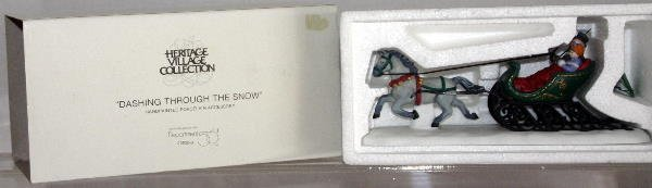 12: DEPT 56 HERITAGE VILLAGE DASHING THRU THE SNOW 5820