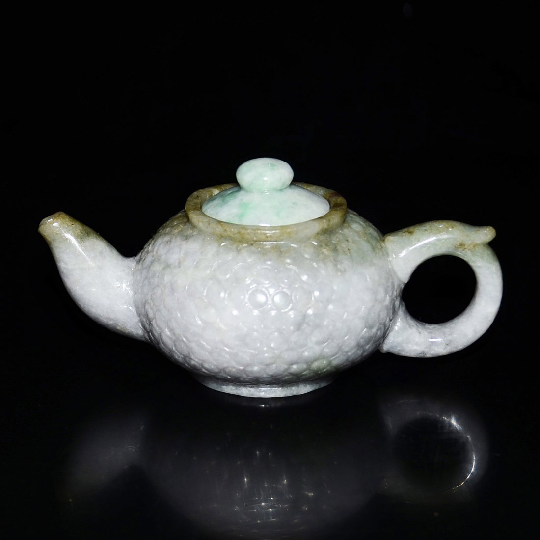 Jade Teapot Carved in Low Relief with Circular Notches