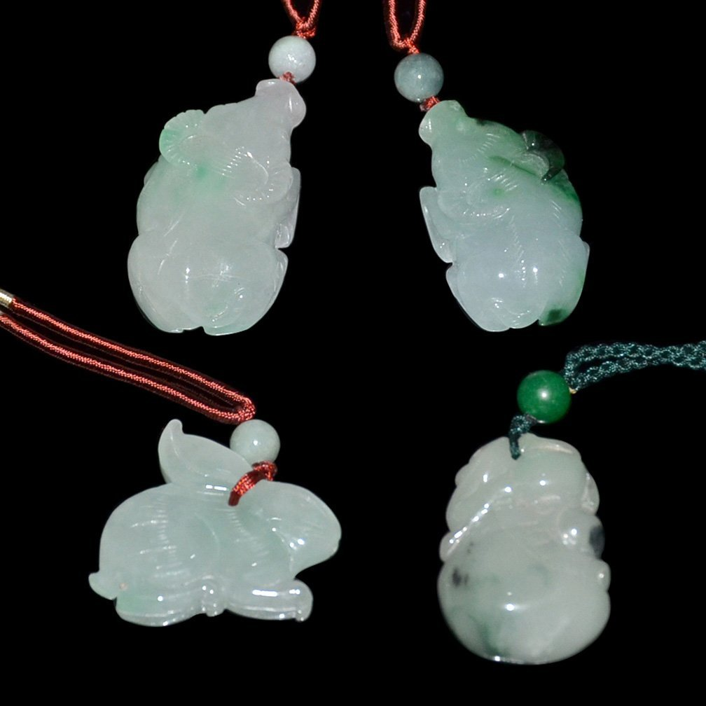 Four Icy Jadeite Pendants:  Buffalo and Rabbit
