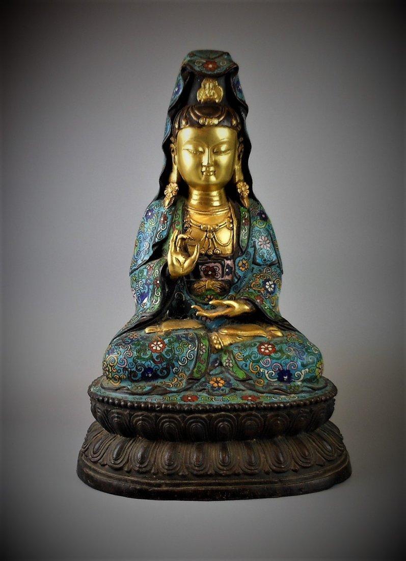 A CHINESE QING DYNASTY GOLD CLOISONNE GUANYIN BUDDHA