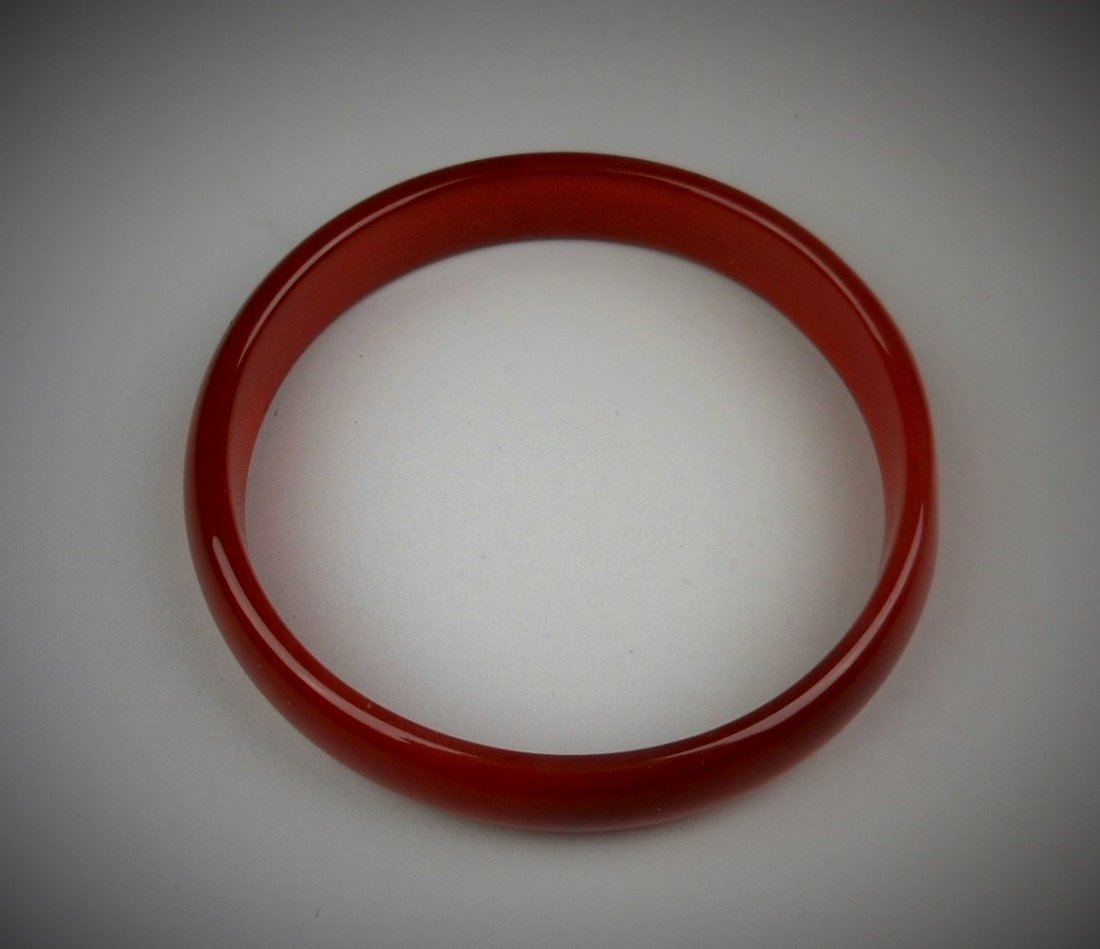 A Chinese red agate bangle