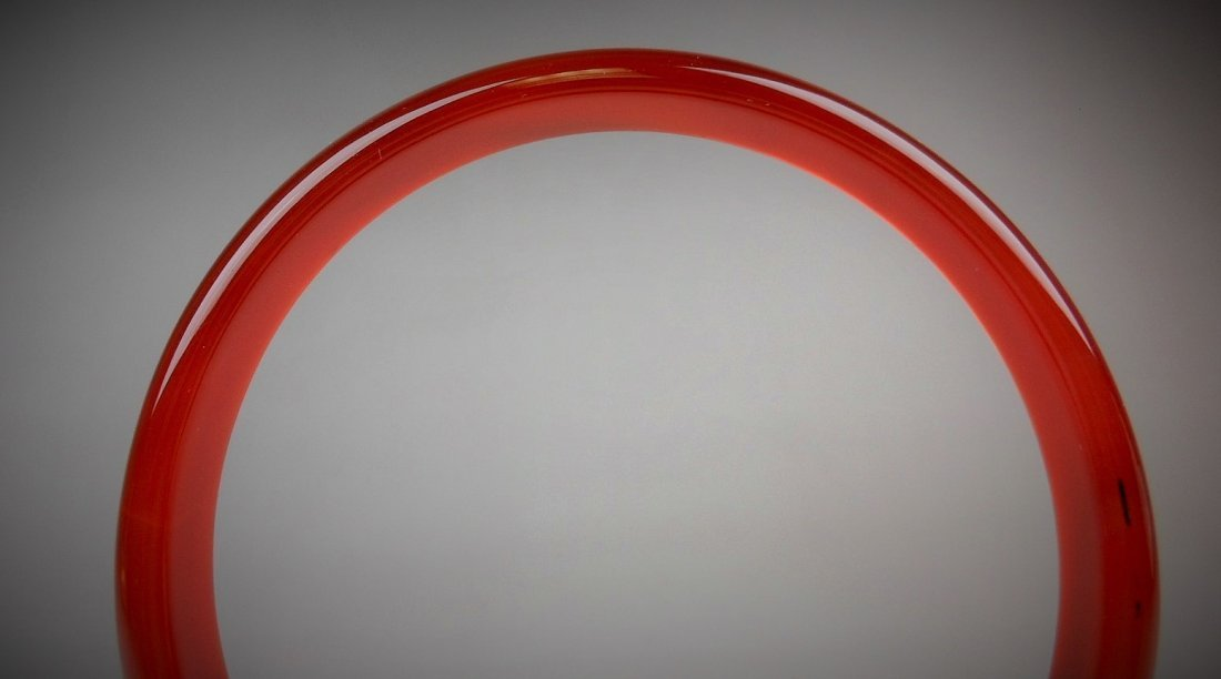 A Chinese red agate bangle - 2