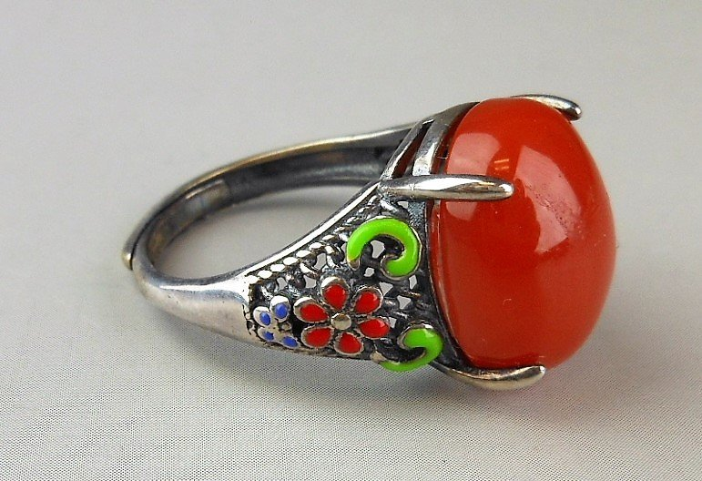 A Chinese red agate silver ring