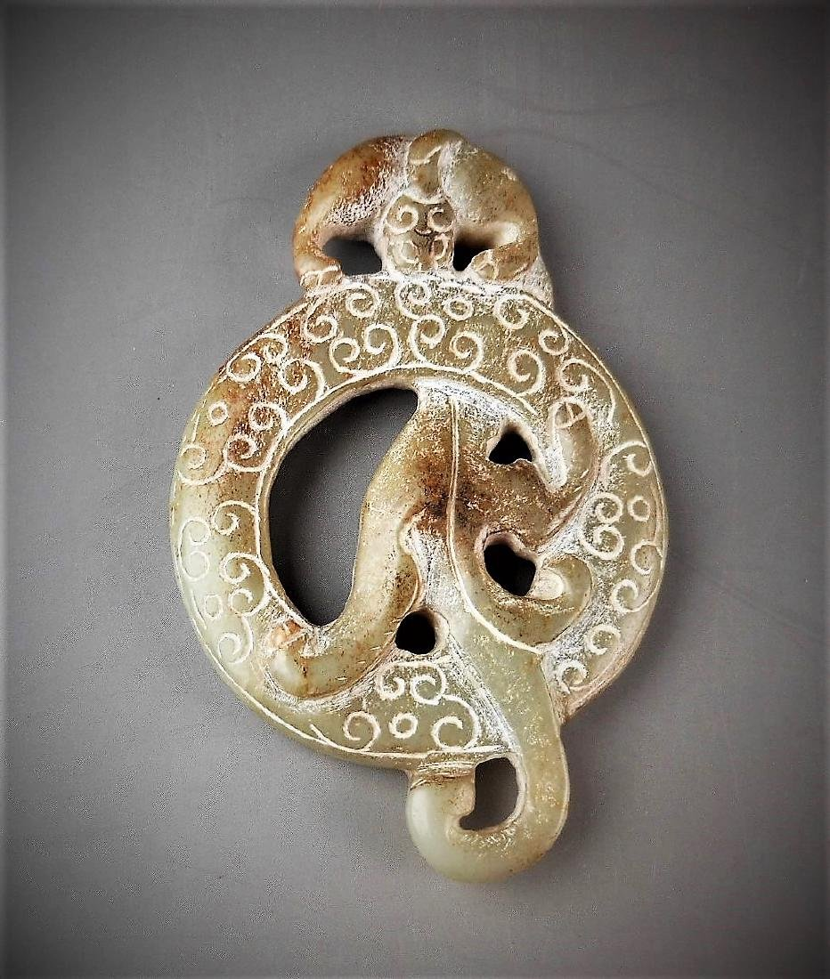 A Chinese archaic jade carved dragon-formed annulus