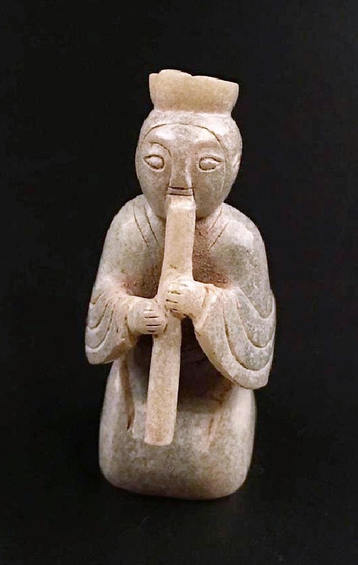 A Chinese archaic jade carved figure