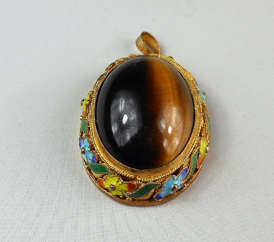 A Chinese tigers-eye pendant