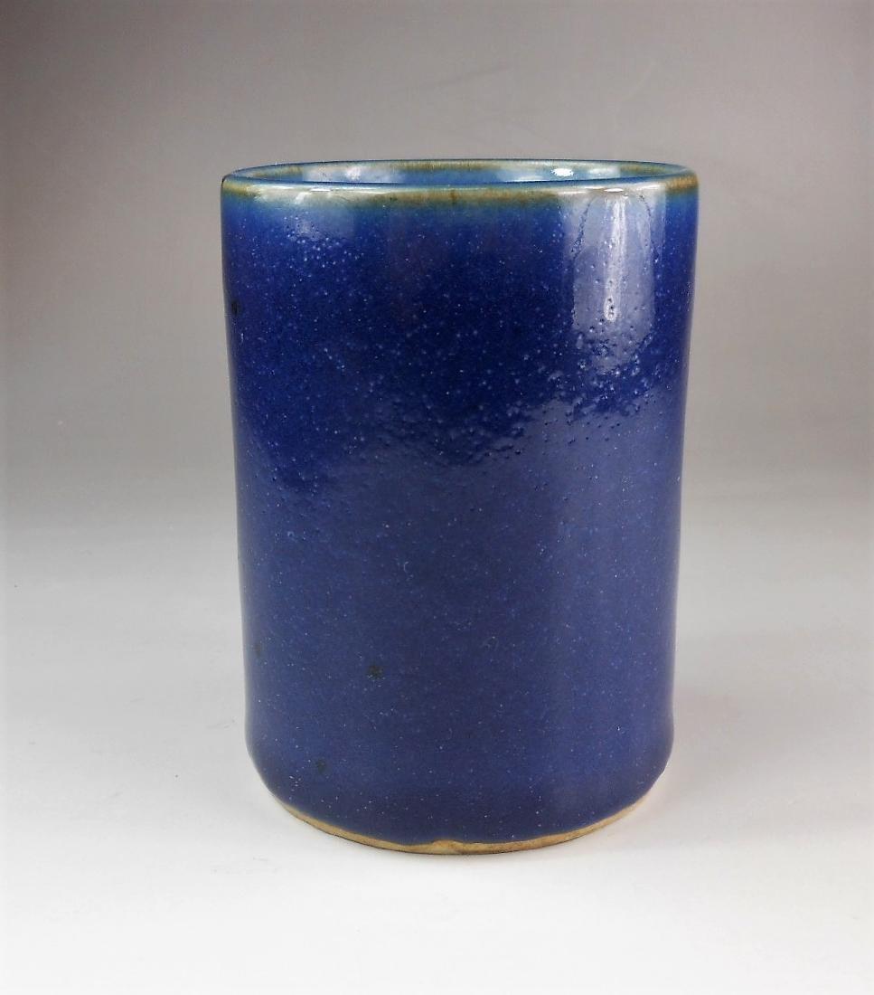 A Chinese Qing dynasty blue glazed porcelain brush