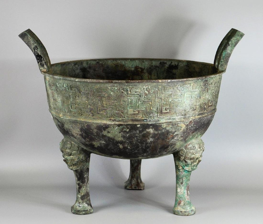 A large Chinese archaic bronze vessel, ding
