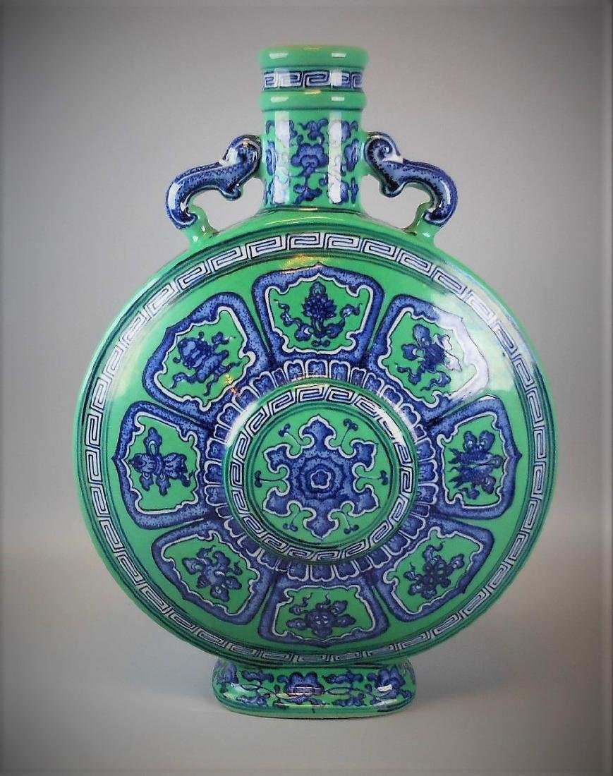 A Chinese Qing dynasty blue and white with green glazed