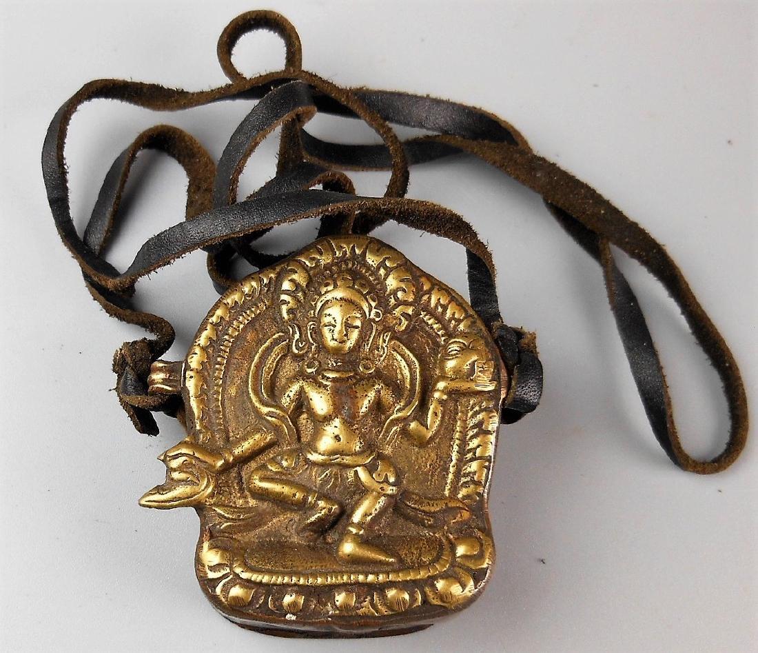 A Chinese antique gilt bronze Buddha pendant