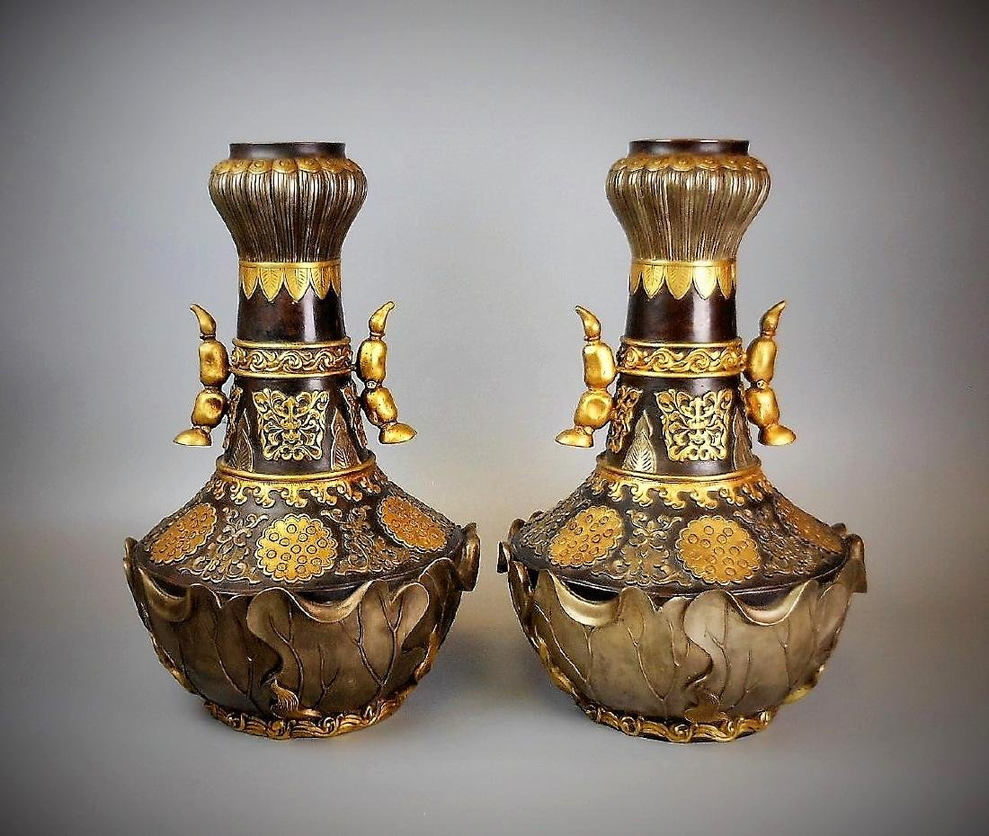 A pair of Chinese Qing dynasty bronze gilt carved vase