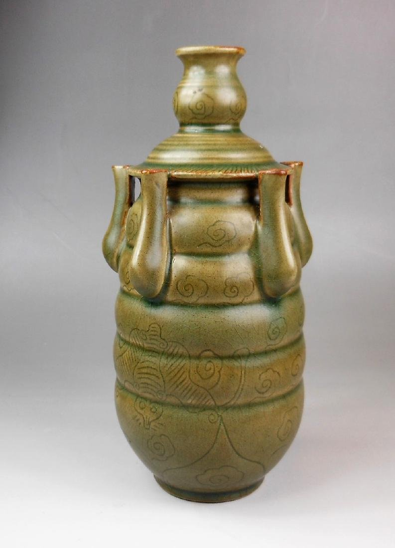 A Chinese Song dynasty Yue-yao celadon five pipe vase