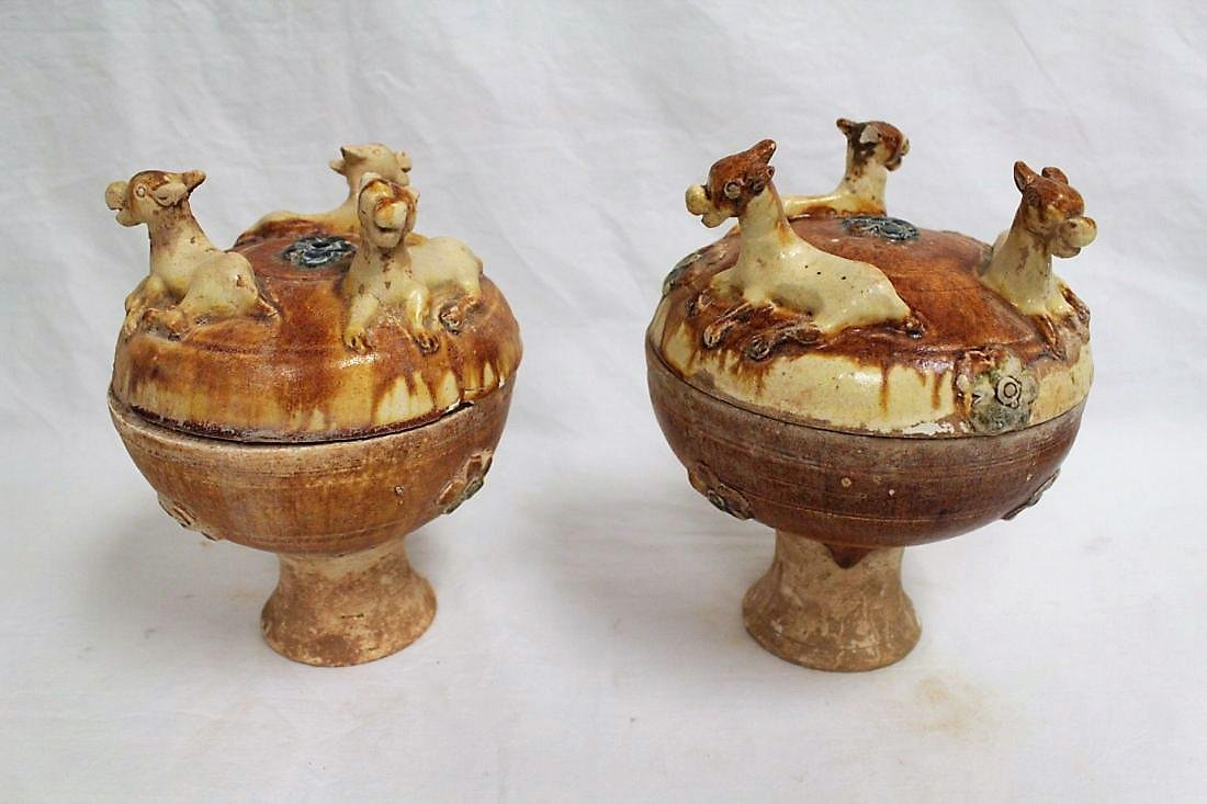A pair of Chinese Tang period pottery food jar (dou)