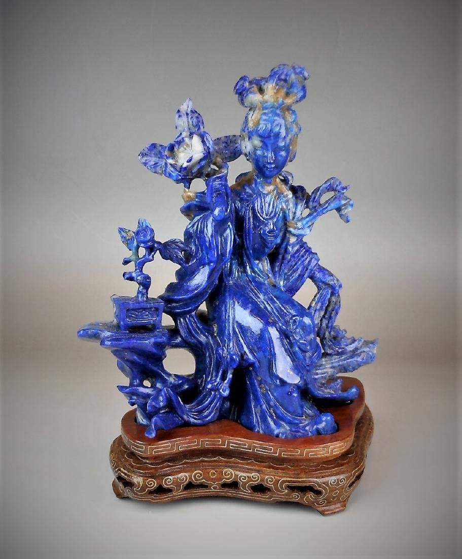 A Chinese lapis carved with figure and flowers
