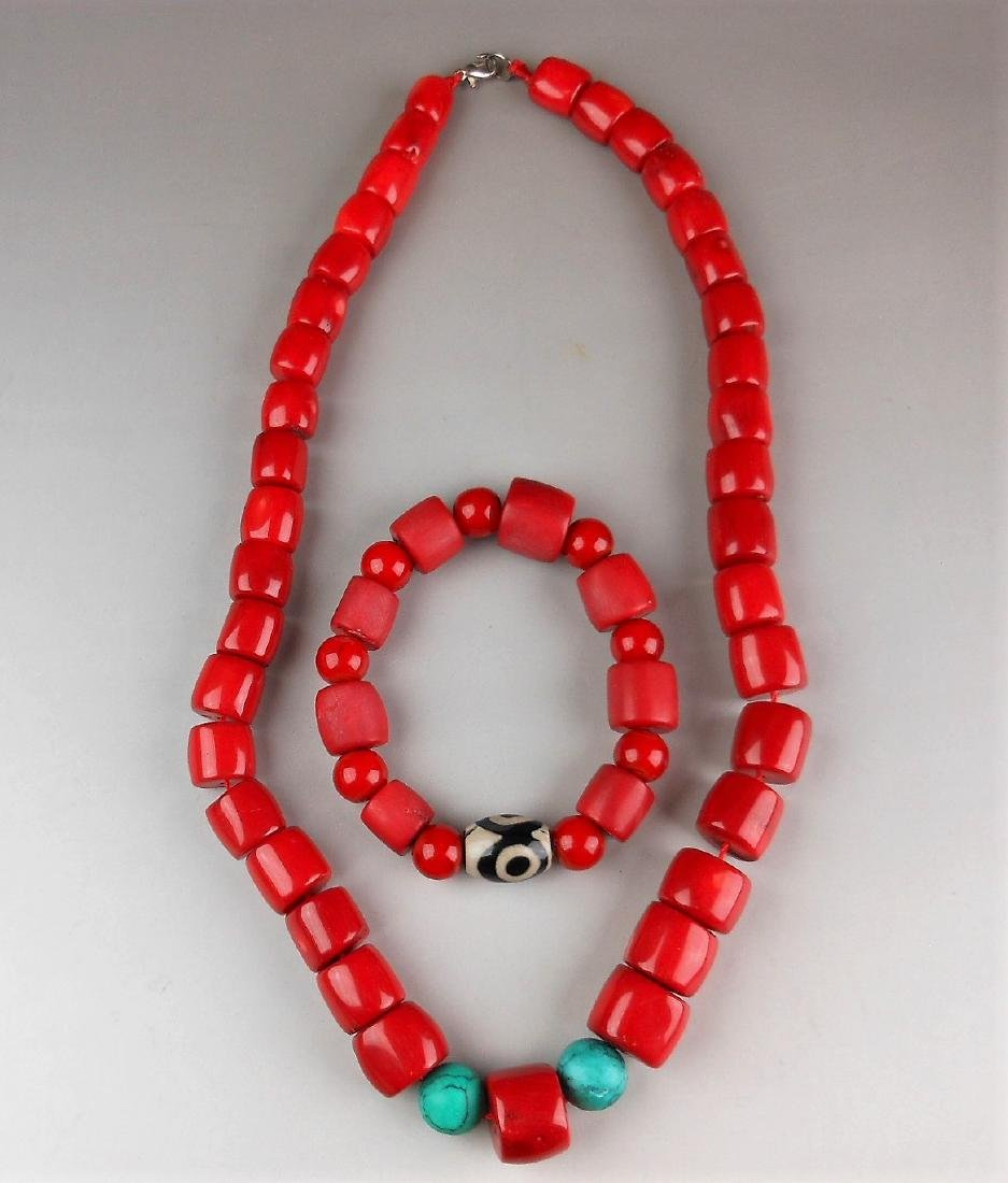 A Chinese coral necklace and a bracelet