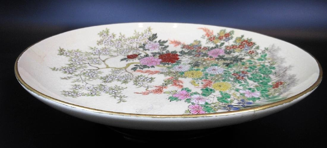 A large Japanese porcelain famille rose plate